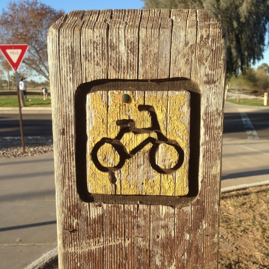 A cool wooden sign with a bike carved into it